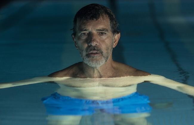 Actor Antonio Banderas floats in a swimming pool with his head above the surface of the water