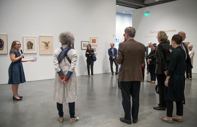 Apsara DiQuinzio leading a gallery tour.
