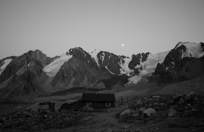 Moonrise over cabin and snowcapped mountains -- BAMPFA