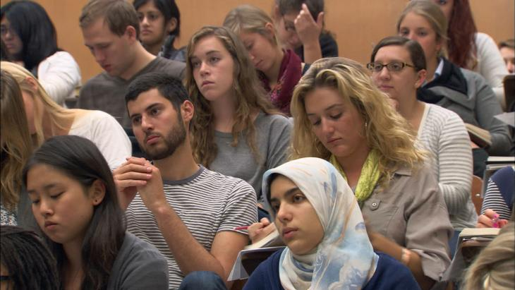 Still from the film 'At Berkeley' (Frederick Wiseman, 2013). A diverse group of college students sit in an auditorium during a class lecture.