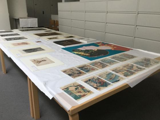 Art laid out for a Five Tables viewing at BAMPFA
